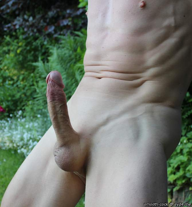 Erect penis outdoors